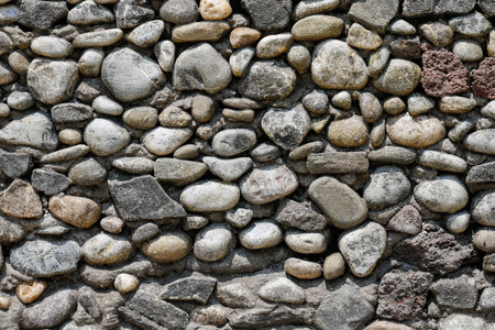 Round river stone wall texture
