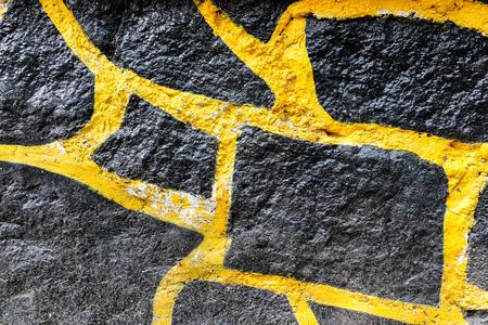 Black and yellow rock wall texture Фото со стока