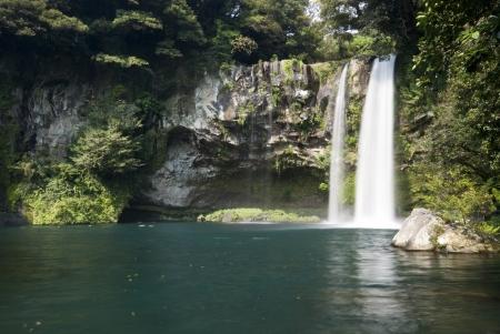 cascading: Cheonjiyeon Waterfall in Jeju Island, Korea