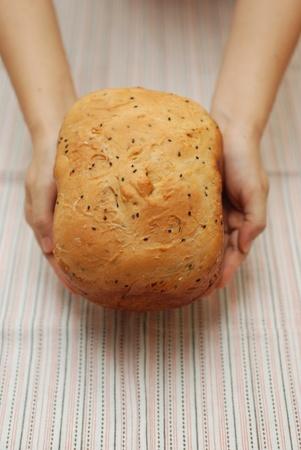 Presenting freshly baked bread Stock Photo