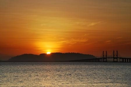 Sunrise over Penang bridge Stock Photo
