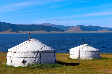 Mongolian gers at Black Lake on a sunny day