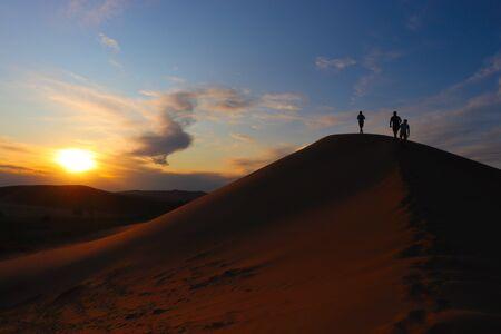People walking on mongolian dunes