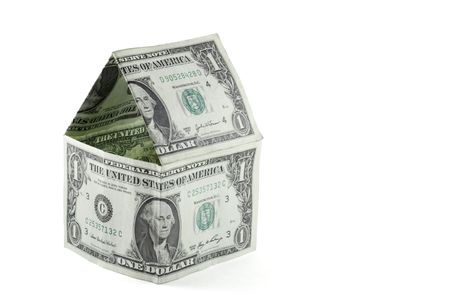 House made of one dollar bills, affordable housing concept. Includes clipping path.