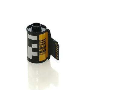 Roll of film with SD card coming out with clipping path, digital photography concept