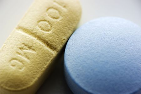 Blue and yellow pill macro with shallow depth of field Stok Fotoğraf
