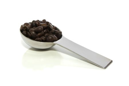 Scoop of coffee isolated on white with clipping path Stok Fotoğraf