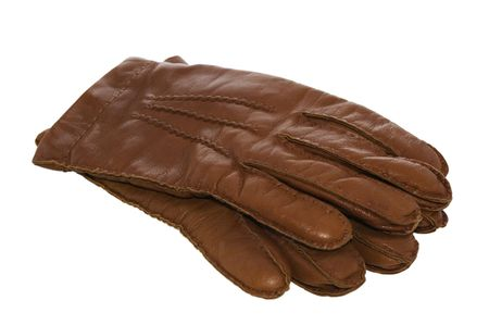 Brown leather gloves isolated on white with clipping path photo