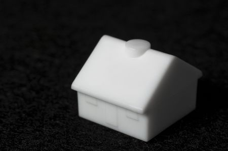 Macro plastic toy house isolated on black felt Stock Photo - 6389879