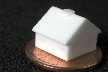 Macro plastic toy house on a penny