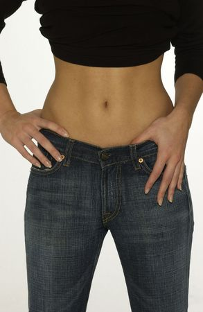 belly button: woman shows her slim waist Stock Photo