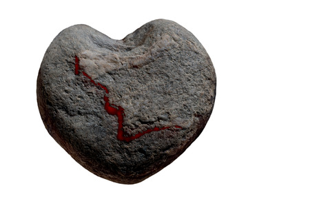 lovesickness: heart-shaped stone with a bloody disruption in front of a white background