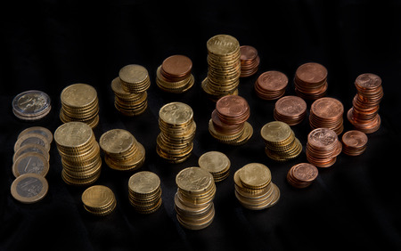 fluting: a lot of different high stacked heaps of Euro coins