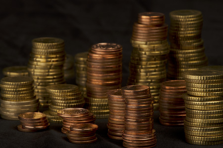 a lot of different high stacked heaps of Euro-Cent coins photo