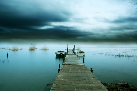 wooden boat: A storm comes on the lake night