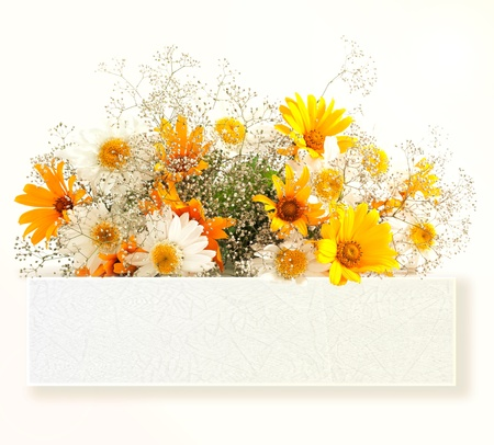 Bouquet with yellow flowers and white paper emblem on white background