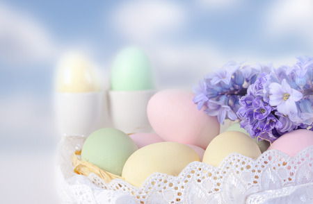 lance: Colorful easter eggs decoration with lance and purple flowers Stock Photo