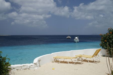 two deckchairs on a white caribbean beach viewing the blue ocean Stock Photo