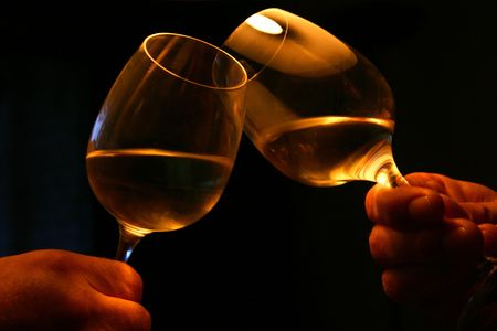 Two glasses toasting with dark background. Special atmosphere photo