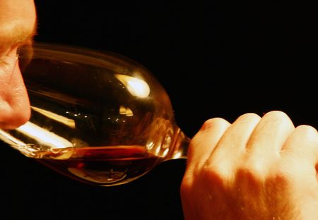 Male smelling red wine in a big wine glass