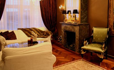 antique interior in Empire style with fireplace and drapes photo