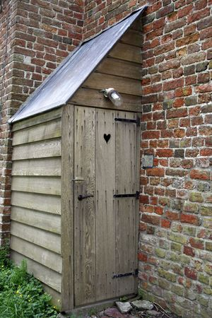 roughing: old wooden outhouse attached to medieval church