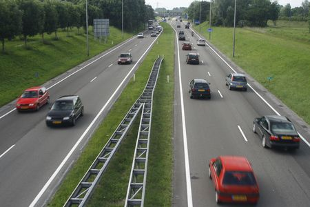 not too heavy traffic on two two-lanes highway with a slight motion blurr on cars Stock Photo - 1052520
