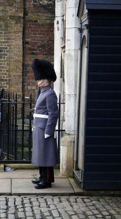 james: royal guard standing at entrance of St. James palace in London