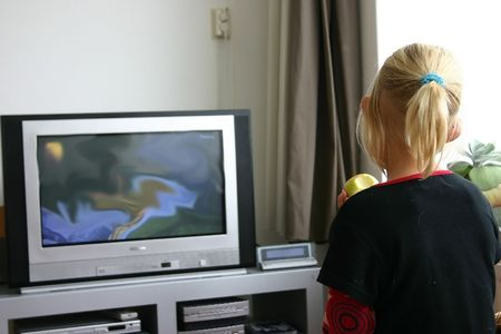 young girl watching television Stock Photo