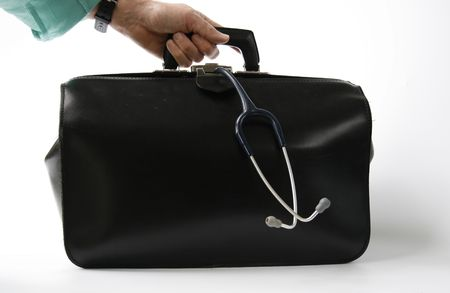 hand holds big black leather doctors bag with stethoscope hanging out