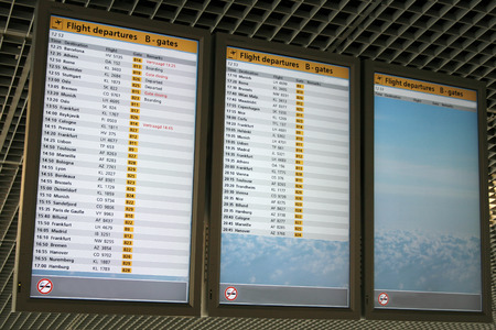 arrival departure board: digital airport departure boards on airport Editorial