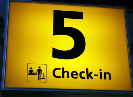 departing: check in sign at airport with number five