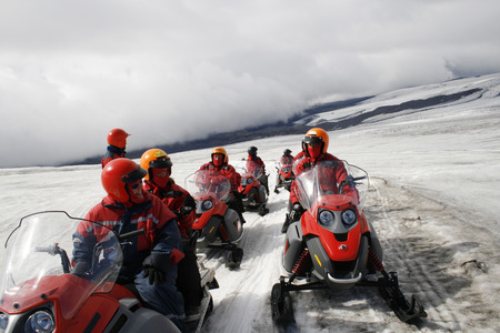 group of people on snow mobiles Stock Photo