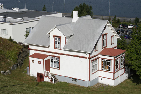 beautiful white and red wooden mansion with grey roof at lake front Stock Photo - 1583337