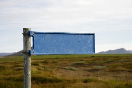 Blank blue signpost. Blue sign in focus hay in background unfocused Stock Photo - 1584800