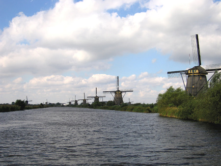long row of 17th and 18th century windmills on famous spot at Kinderdijk in the Netherlands Stock Photo - 1686442