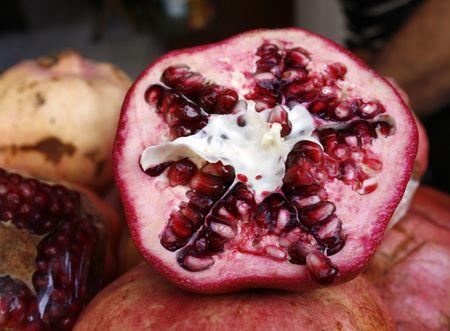 half open: Half open pomegranate in close up