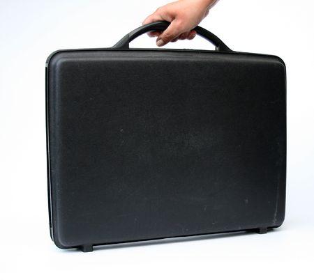 attache case: hand holds black attache case