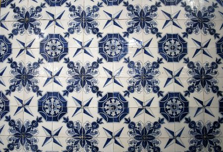 blue and white ceramical tiles on old monumental wall