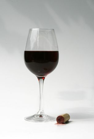 liquid state: crystal wine glass with red wine and cork with a bit of spilled wine