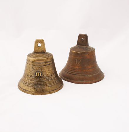 knell: two bells isolated on white. One copper one bronze Stock Photo