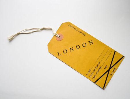 vintage yellow luggage label for flight to London in 1948
