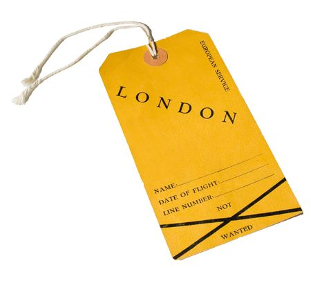 Vintage yellow airline luggage label tagged London. Used in 1948. Isolated on white