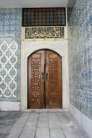 Ancient wooden door in harem Topkapi palace in Istanbul photo