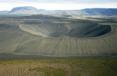 Deep crater seen from helicopter with other craters in the back. Myvatn area in Iceland photo