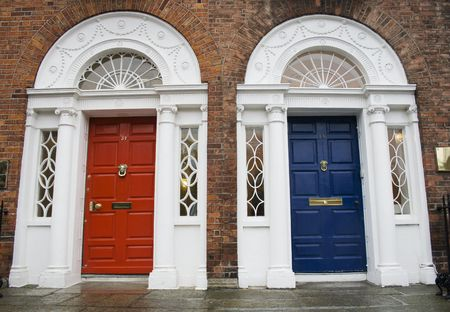 fanlight: Dublin red and blue doors in Georgian architecture Stock Photo