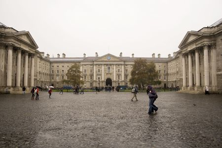 students with umbrellas on rainy grounds of Trinity college in Dublin, Ireland Stock Photo - 2158527