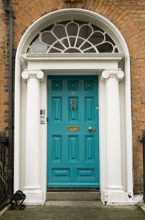 Original turquoise colored door in Georgian Dublin  photo