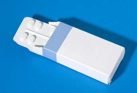 two packages of pills in a blue and white box Stock Photo