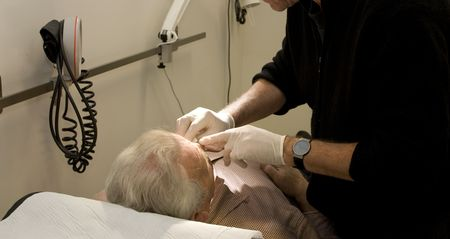 treated: senior male patient is treated by doctor